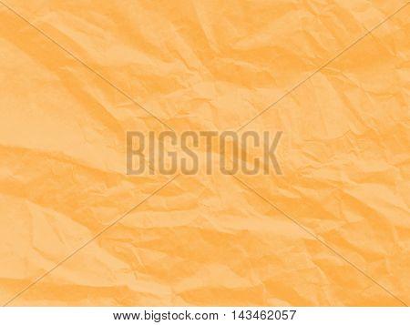Art paper texture. Unique crumpled soft orange color of paper sheet for background.