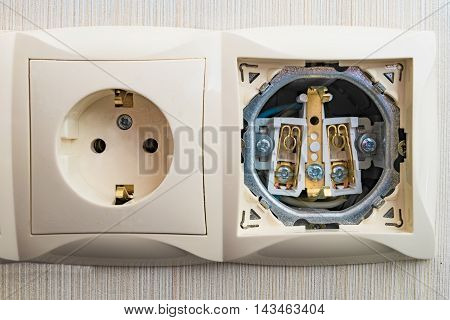 Detail of electric outlet block connection point and open electric socket strip without front panel of a close-up connection
