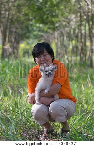 Asia Woman And Her Dog At  Rubber Tree Natural Latex