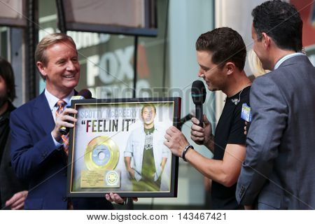 NEW YORK-JUL 31: (L-R) Steve Doocy, Scotty McCreery and Brian Kilmeade at Fox and Friends' All-American Summer Concert Series at 48th Street and 6th Avenue on July 31, 2015 in New York City.