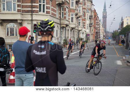 Copenhagen, Denmark - August 21, 2016: Triathletes cycling in the city center at the KMD Ironman Copenhagen event