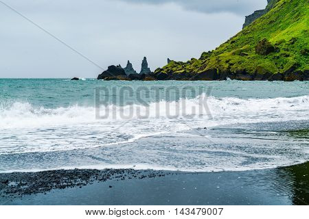 View of mount Reynisfjall and Famous Reynisdrangar rock formations at Back Beach in the Village of Vik Iceland