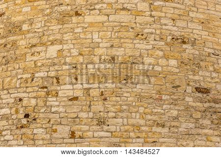 Stone wall background - Texture image composed from an aged stone wall sharp details and interesting curves.