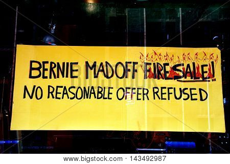 New York City - July 24 2009: Amusing Bernie Madoff fire sale sign in a guitar shop on West 23rd Street in Chelsea
