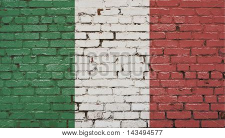 Brick wall with painted flag of Italy