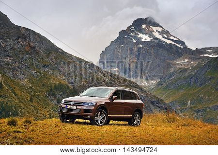 Rhemes Notre Dame, Valle d'Aosta, Italy - July 25, 2016: Volkswagen Touareg ІІ Showy Volkswagen Touareg ІІ in alps with background view of Granta Parey mountain. Photo captured in the alpine mountains
