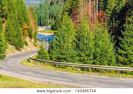 Mountain Road Near River In Autumn Forest