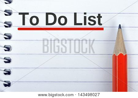 To do list text on notepad and red pencil