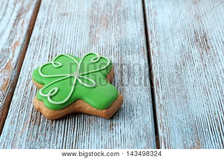 Decorative cookie on wooden background. Saint Patrics Day concept