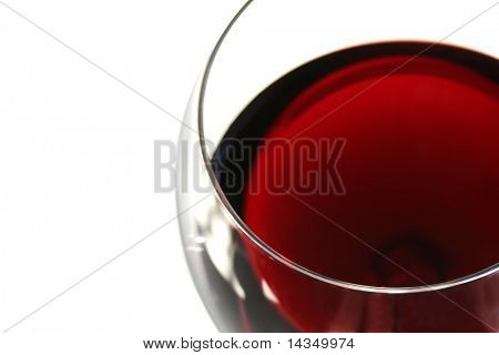 Closeup of a glass of red wine with white background.  Shallow DOF.