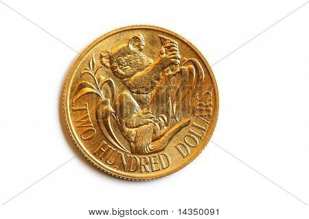 An Australian gold $200 coin, isolated on white.  Commemorative issue, uncirculated.