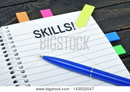 Skills word on notepad and pen