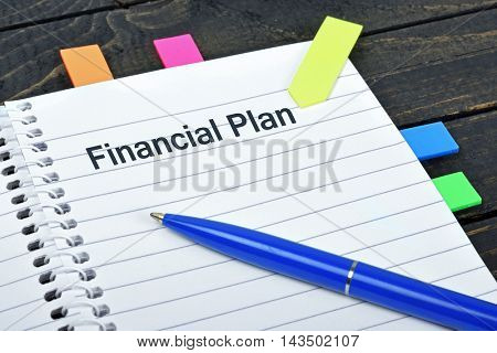 Financial Plan word on notepad and pen