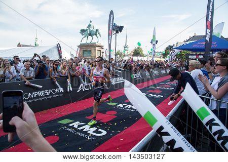 Copenhagen, Denmark - August 21, 2016: Triathlete Will Clarke just before crossing the finish line as 2nd in men's at the KMD Ironman Copenhagen 2016 in 07:59:31