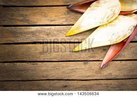 Banana blossom slice on wooden background.Raw food or background food.1