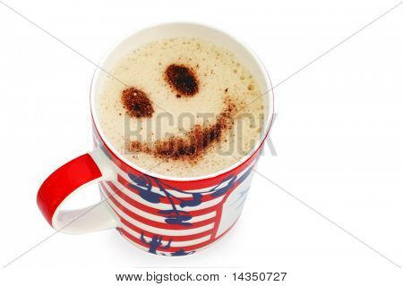 Cup of coffee with a chocolate smiley sprinkled on top.  Isolated on white.
