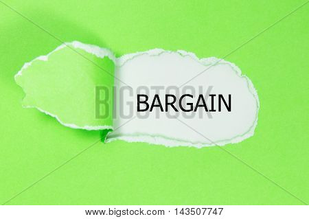BARGAIN word written under torn green paper.