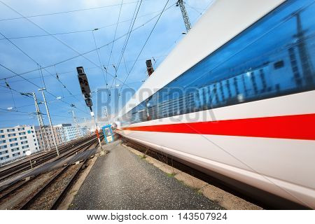 Modern High Speed Passenger Train On Railroad Track In Motion