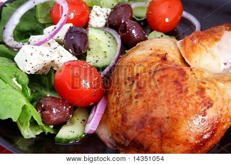Roast chicken and Greek salad, with cos lettuce, red onion, black olives, grape tomatoes, fetta cheese, and herbs.