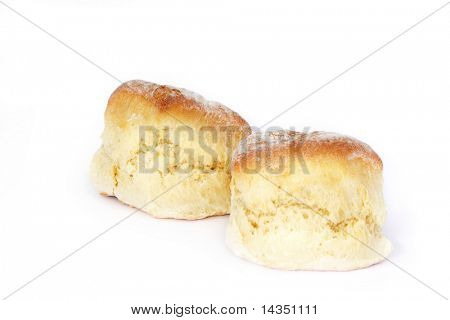 Two fresh-baked scones, isolated on white.