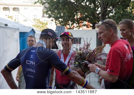 Copenhagen, Denmark - August 21, 2016: The 3rd Fabio Carvalho and the 5th Igor Amorelli in men's after finishing the KMD Ironman Copenhagen 2016