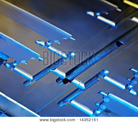 Metallic abstract.  Core of an injection moulding die, in close-up.  Industrial background.