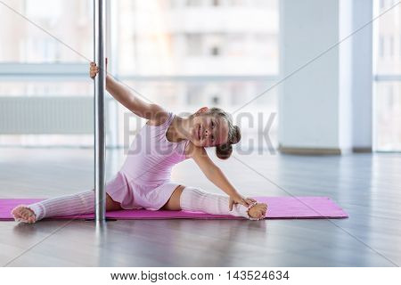 Adorable girl dancer in the ballet studio
