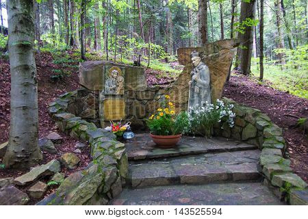 Komancza Poland - July 20 2016: Chapel of Mary and the figure of the Polish primate Cardinal Wyszynski the woods next to the convent of the Sisters of Nazareth in Komancza. From 1955 to 1956 the monastery was interned Cardinal Stefan Wyszynski