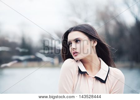 Beautiful Woman with black hair Outdoors. Melancholy Concept