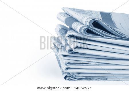 Stack of folded financial newspapers, in blue tone with white background.  Clipping path included.