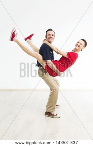 Rock'n'roll dance boogie woogie. Boogie acrobatic stunt in a studio on the white background. Dance for rock-n-roll music.