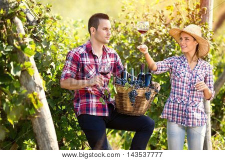 Proudly couple enjoying in wine in vineyard