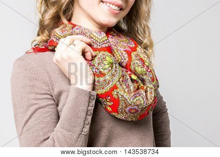 Closeup photo of fashoinable neckerchief with traditional ornaments on beautiful woman