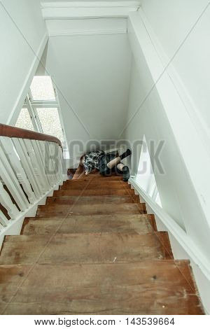 Motionless Injured Boy Lying On The Stairs