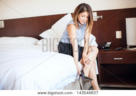 Female Lawyer Getting Dressed In A Hotel Room