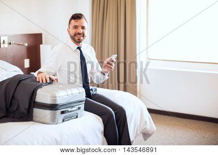 Handsome Businessman Using A Smartphone