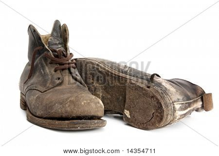poster of Worn-out old work boots, isolated on white.