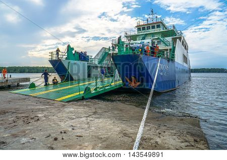 Menumbok,Sabah-Aug 19,2016:Ferry with vehicles on board in the morning,carries passengers and vehicles from Sabah to Labuan island.This is the economical transportation to the Labuan Pearl of Borneo
