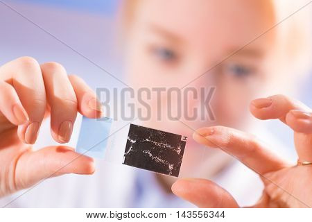 Young woman work with microscope slide
