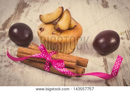 Vintage Photo, Fresh Baked Muffins With Plums And Cinnamon Sticks On Old Wooden Background, Deliciou