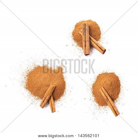 Pile of cinnamon powder with the raw bark sticks on top of it, composition isolated over the white background, set of three different foreshortenings