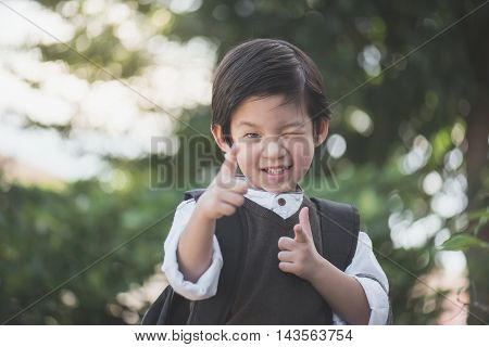 Portrait of Asian student with backpack outdoorsback to school concept