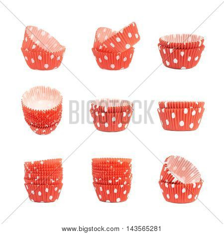 Red polka dot cupcake cups isolated over the white background, set of nine different foreshortenings