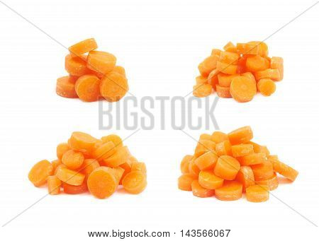 Pile of baby carrot slices, composition isolated over the white background, set of four different foreshortenings