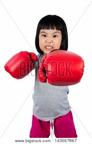 Asian Little Chinese Girl Wearing Boxing Glove With Fierce Expression