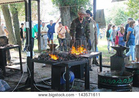 Myrgorod, Ukraine - August 20, 2016: Blacksmith at work on the festival of blacksmiths