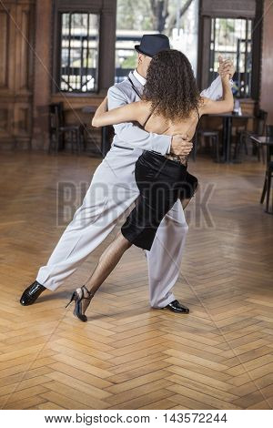 Dancers Performing Tango In Restaurant