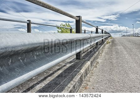 Safety metal guardrail on a rural roadside