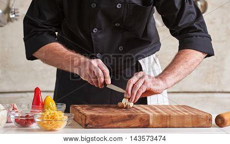 Restuarant Hotel Private Chef Cutting Mushrooms On Board