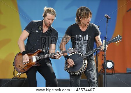 NEW YORK-AUG 12: Keith Urban (R) performs in concert on ABC's